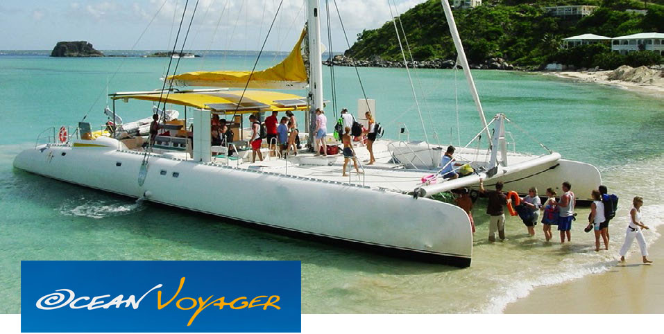 Ocean Voyager catamaran at the beach